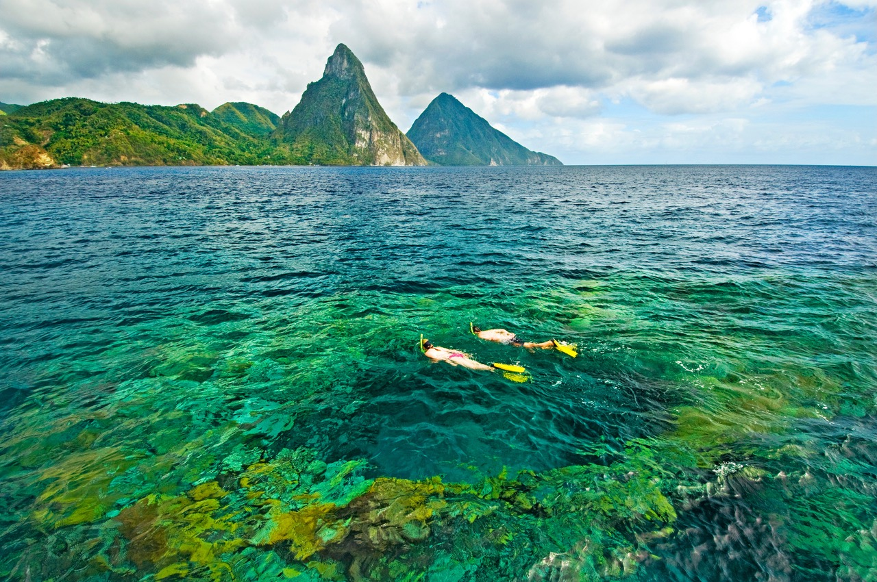 Snorkeling with a Piton backdrop