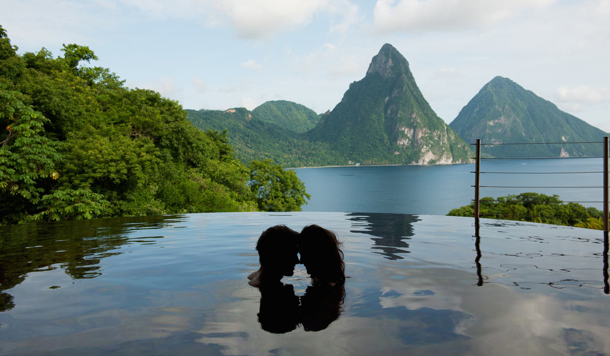 Couple in infinity pool at Jade Mountain